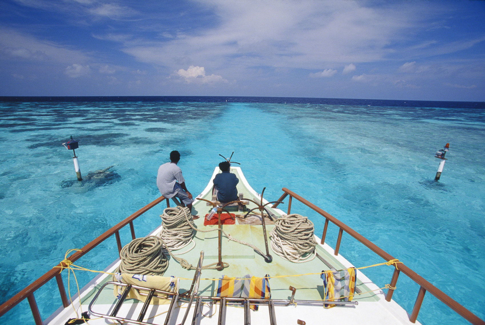 Maldivian Dhoni cuts through the narrow channel of the inter reef, Maldives